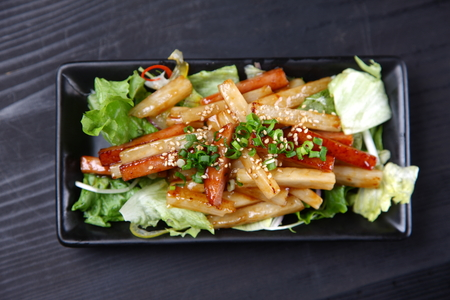 Chinese yam and spam stir fry Banque d'images