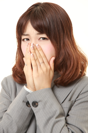 young Japanese businesswoman shocked