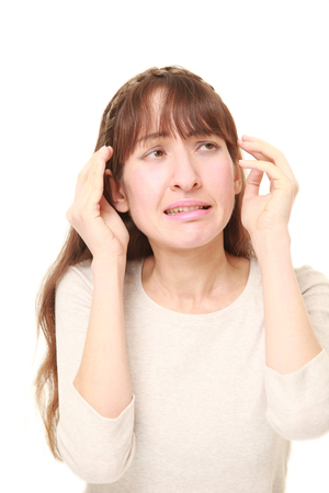 young woman suffers from headache