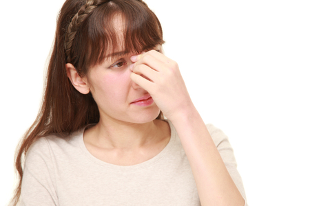 young woman suffers from Asthenopia