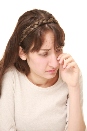 young woman cries