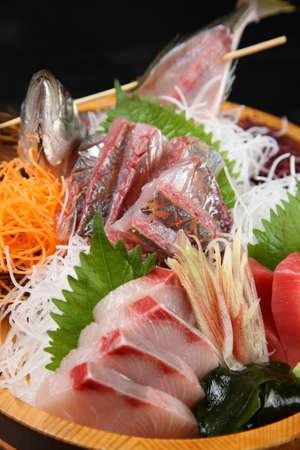 three varieties of fresh sashimi combo tub Imagens