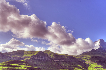 kwazulu natal: Clouds build up against the eastern buttress on Drakensberg amphitheatre.