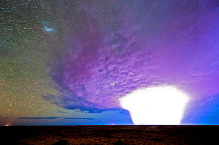 desert storm: Time exposure of a storm passing kielie krankie desert camp in Kgalagadi Transfrontier Park.  Stock Photo