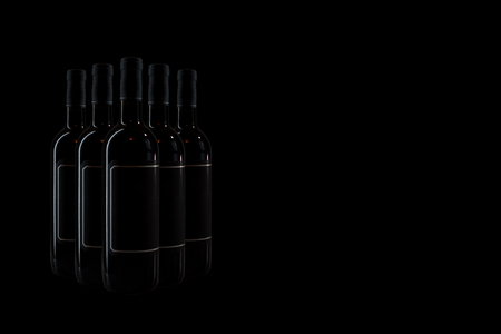 wine bottles against a dark background