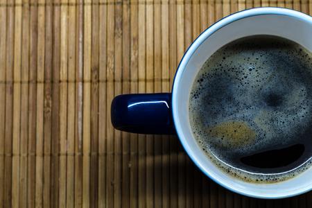 a mug of coffee on the table.