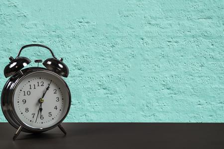 Retro alarm clock on a desk.