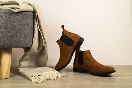 Women autumn shoes or boots on floor.