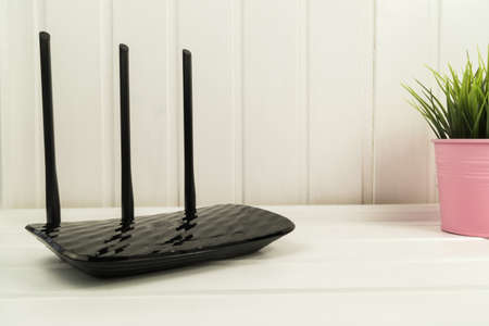 Black WiFi router in living room.