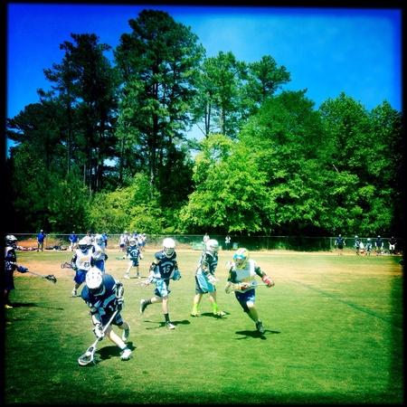 Muchachos equipo de lacrosse Foto de archivo - 28047911