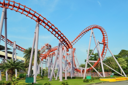 A Colorful Looping Roller Coaster On A Beautiful Sunny Day photo