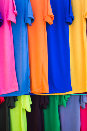 lots of: Lots of bright colorful clothing, abstract background. Stock Photo