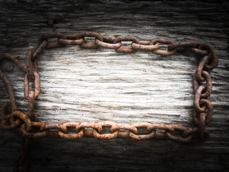 rusty chain: rusty chain on wood background