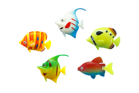 group of fish: group fish toy on isolated Stock Photo