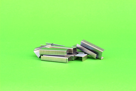staples on isolated green