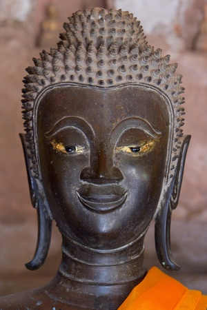 Ancient Buddha sculptures in the cloister of Wat Si Saket in Vientiane, Laos Stock Photo