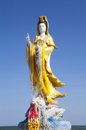 Guanyin statue by the sea in the resort town Bang saen in Thailand photo
