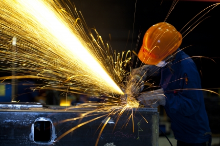 Factory worker using electric grinder - a series of METAL INDUSTRY images