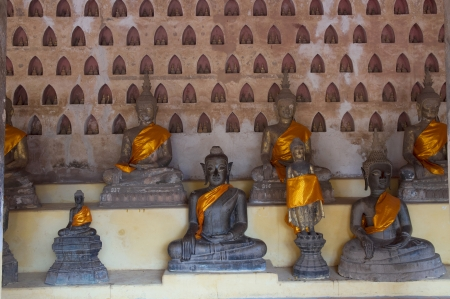 face centered: Ancient Buddha sculptures in the cloister of Wat Si Saket in Vientiane, Laos Stock Photo