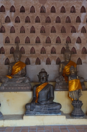 preceded: Ancient Buddha sculptures in the cloister of Wat Si Saket in Vientiane, Laos Stock Photo