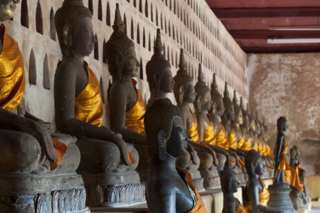 Ancient Buddha sculptures in the cloister of Wat Si Saket in Vientiane, Laos photo