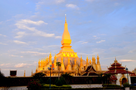 tunable: Pha That Luang, the golden stupa on the outskirts of Vientiane, Laos, that has become a national symbol for the nation  Photo taken during sunrise  Stock Photo