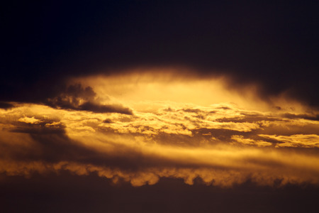 one golden morning with the golden rays of sun reflected by the clouds