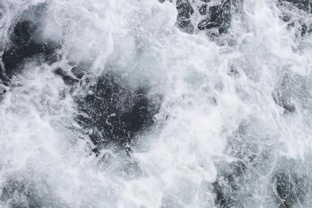 Big ocean wave breaking the shore photo