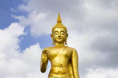 godhead: Phra buddha mongkhon maharaj; The largest standing buddha Statue in southem region.  Hatyai Songkhla Thailand. Stock Photo