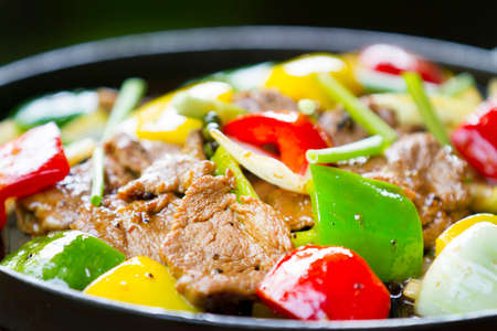 pepper: Chinese pepper steak - slices of tender beef stir-fried with red and green bell peppers and onions.