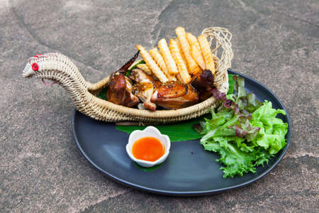 edibles: roasted chicken leg with fries potato and herbs