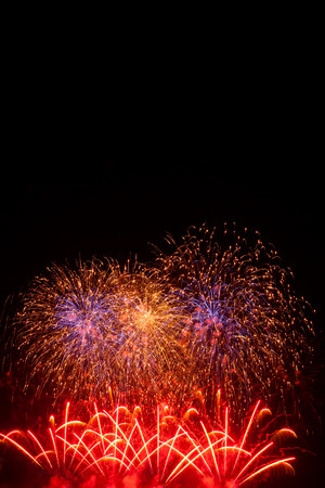 antecedents: Brightly colorful fireworks in the night sky