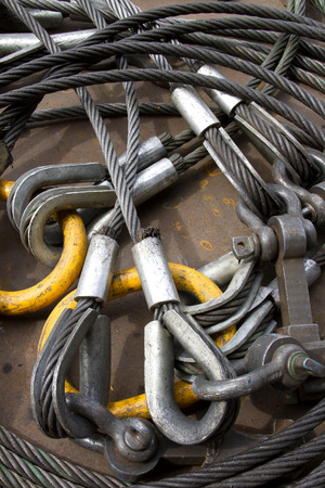 shackle: Heavy duty steel wire rope sling with safety anchor shackle bolt in construction site. Stock Photo