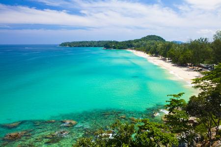 surin: Surin Beach with large boulders in Phuket Thailand