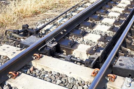 railway tracks: Railway Tracks and Switch near Train Station. Stock Photo