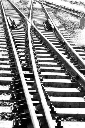 crossings: Railroad tracks at a train station Thailand.black and white picture