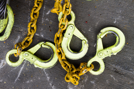 machinery space: Hoist the heavy lifting,Large chains  Painted yellow.