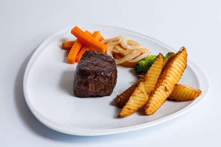 Grilled beef steaks and vegetables,luxury hotel food.