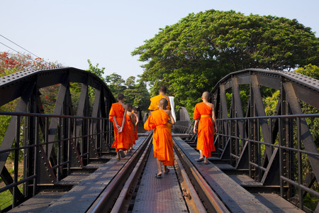 Go on a trip with the monks, Bridge on the river kwai, Kanchanaburi province Thailand Editorial