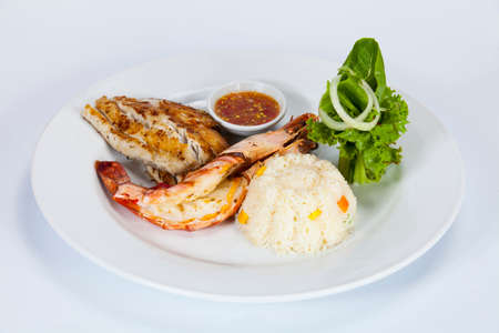 discus: Fried rice with vegetables,Seafood menu. There are fish and shrimp,Thai food in a luxury hotel. Stock Photo