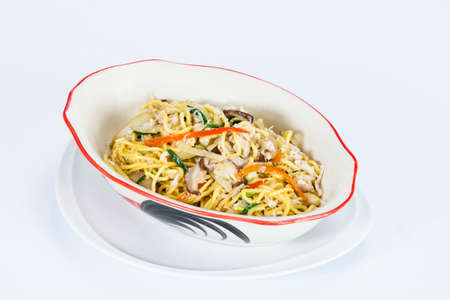 phuket food: Traditional Phuket style fried yellow noodle with chicken or pork,Thai food in a luxury hotel. Stock Photo