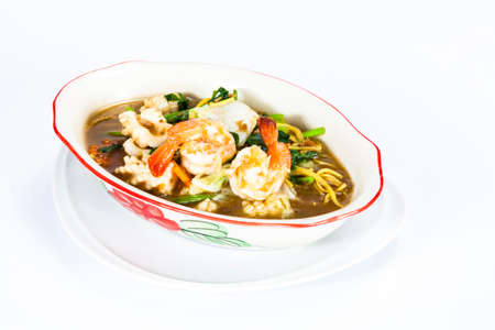 crispy yellow noodle with in a creamy gravy sauce : chinese and thai style food. in thai language call is  Rad Na Mee Krob