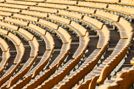 Stadiums and empty seats and have an orange light like the sun. A place public government creates to the public. Stock Photo