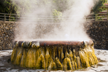 volcanic natural hot spring mineral water pool with steam spa and sun reflect light travel landmark background lampang thailand landscape colorful dark tone, Ruksavarin Hot Spring  Ranong Thailand.