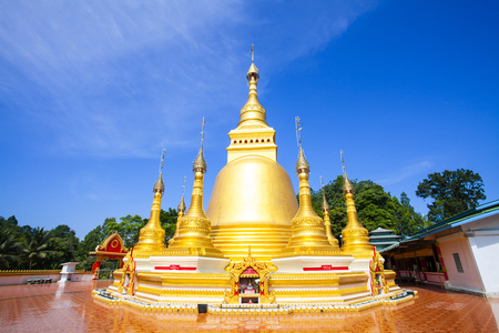 stupa: Golden pagoda at Wat Varee Banpot, Wat Bang Non,Ranong Province,Ancient Thai temple.
