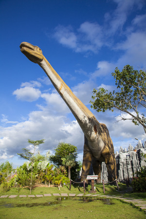pm: 20 September 2016 At the Dinosaur park Dannok Sadao District, Songkhla in Thailand opening hours 10.00 am. - 10.00 pm. In the morning have sunrise and blue sky make it beautiful.