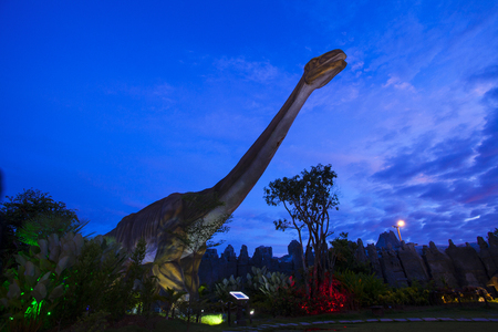 pm: -20 September 2016 At the Dinosaur park Dannok Sadao District, Songkhla in Thailand opening hours 10.00 am. - 10.00 pm. In the evening have the blue sky and the light make it beautiful. Editorial