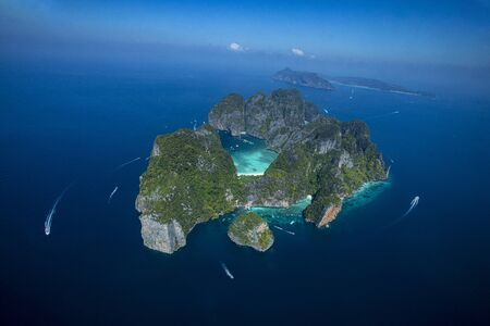 Aerial view of Phi-Phi Leh island with Maya Bay and Pileh Lagoon. Krabi province, Thailand. Top view of isolated rocky tropical island with turquoise water and white beach.