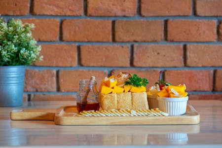 Mango Tango Honey Toast,Honey Toast with mango,Vanilla ice cream and whipped cream dessert. Stock fotó