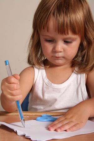 child writing with blue pen Stock Photo - 555430
